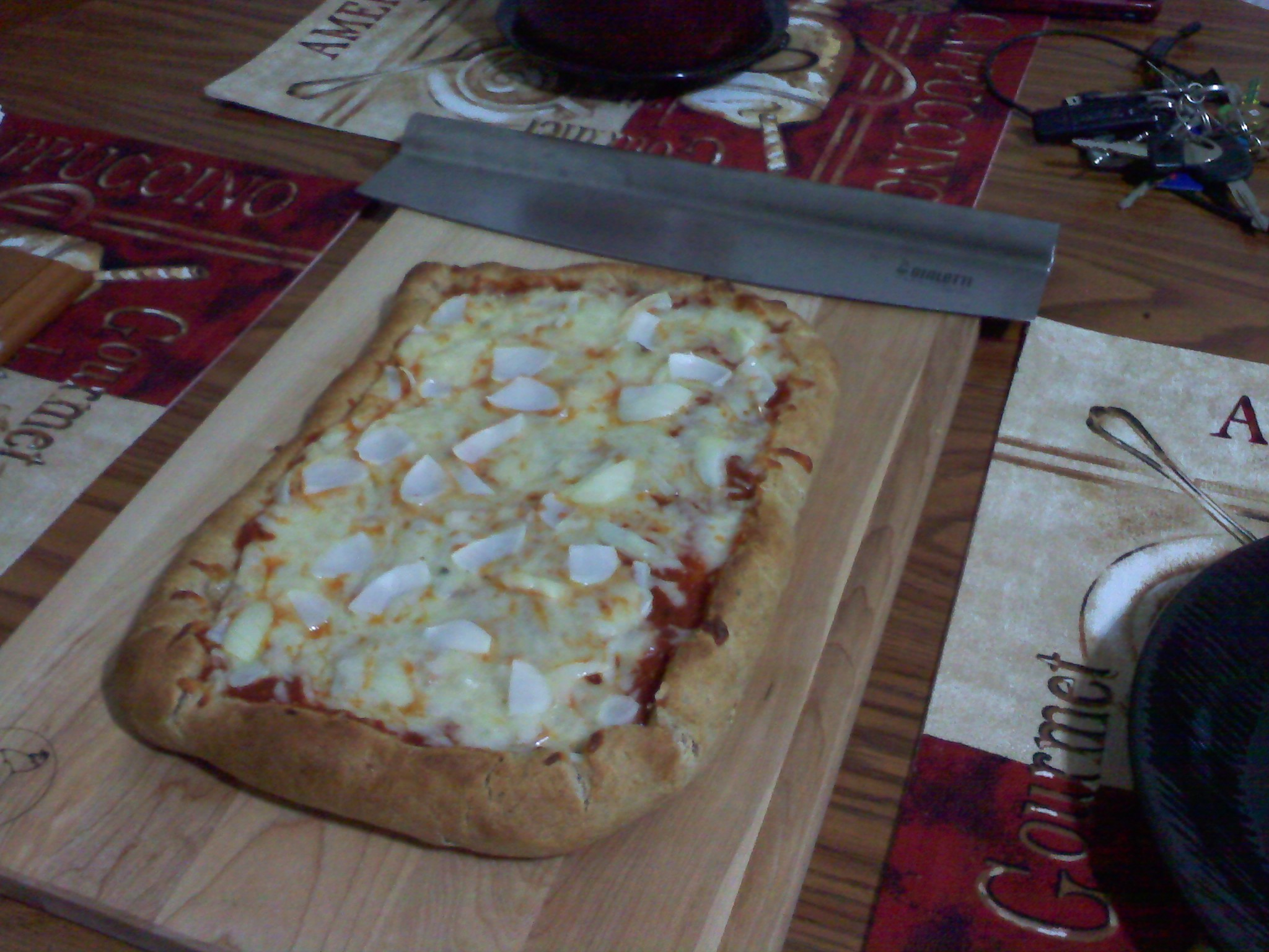 New Britain CT :: Aunt Vesta's homemade pizza dough recipe with Italian pizza sauce, some mozzarella cheese and onions! :)