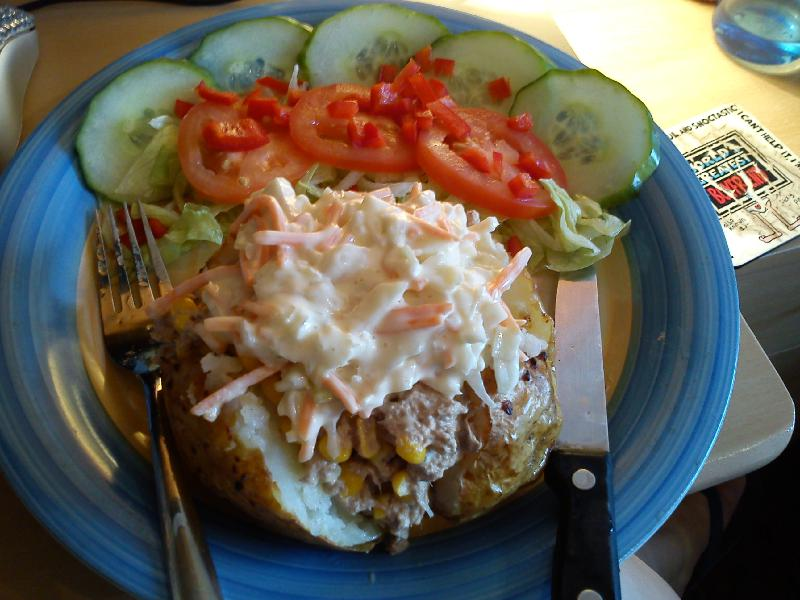 manchester u.k :: jacket potato filled with tuna, sweetcorn and colslaw, served with salad