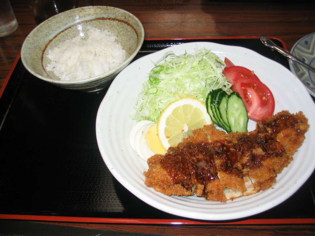Tokyo :: My first post on this site! This is perhaps my favorite Japanese dish, Tonkatsu. It's a pork cutlet breaded with panko with sause on top served with rice. So good!