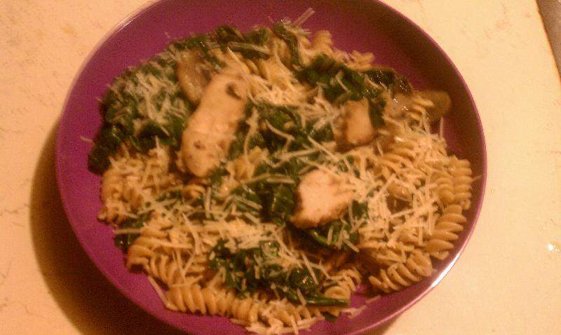 Ferndale, MI :: Pasta with sauteed spinach and mushrooms with grilled chicken strips.