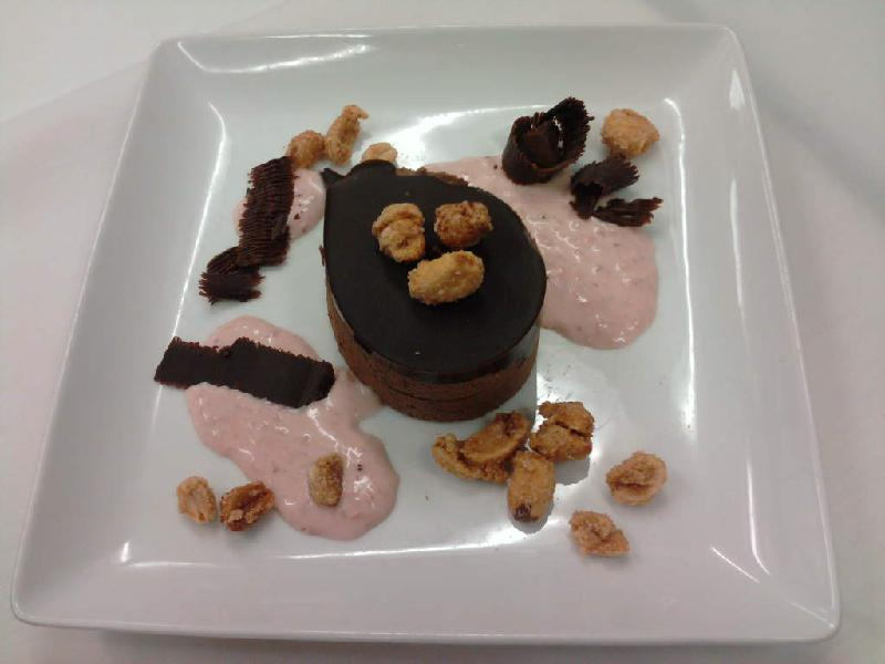 eastern ct :: chocolate peanut butter mousse with sugared peanuts and strawberry cremma. I tried to shave some chocolate for spirals but it didn't cooperate so the garnish looks like crap ha