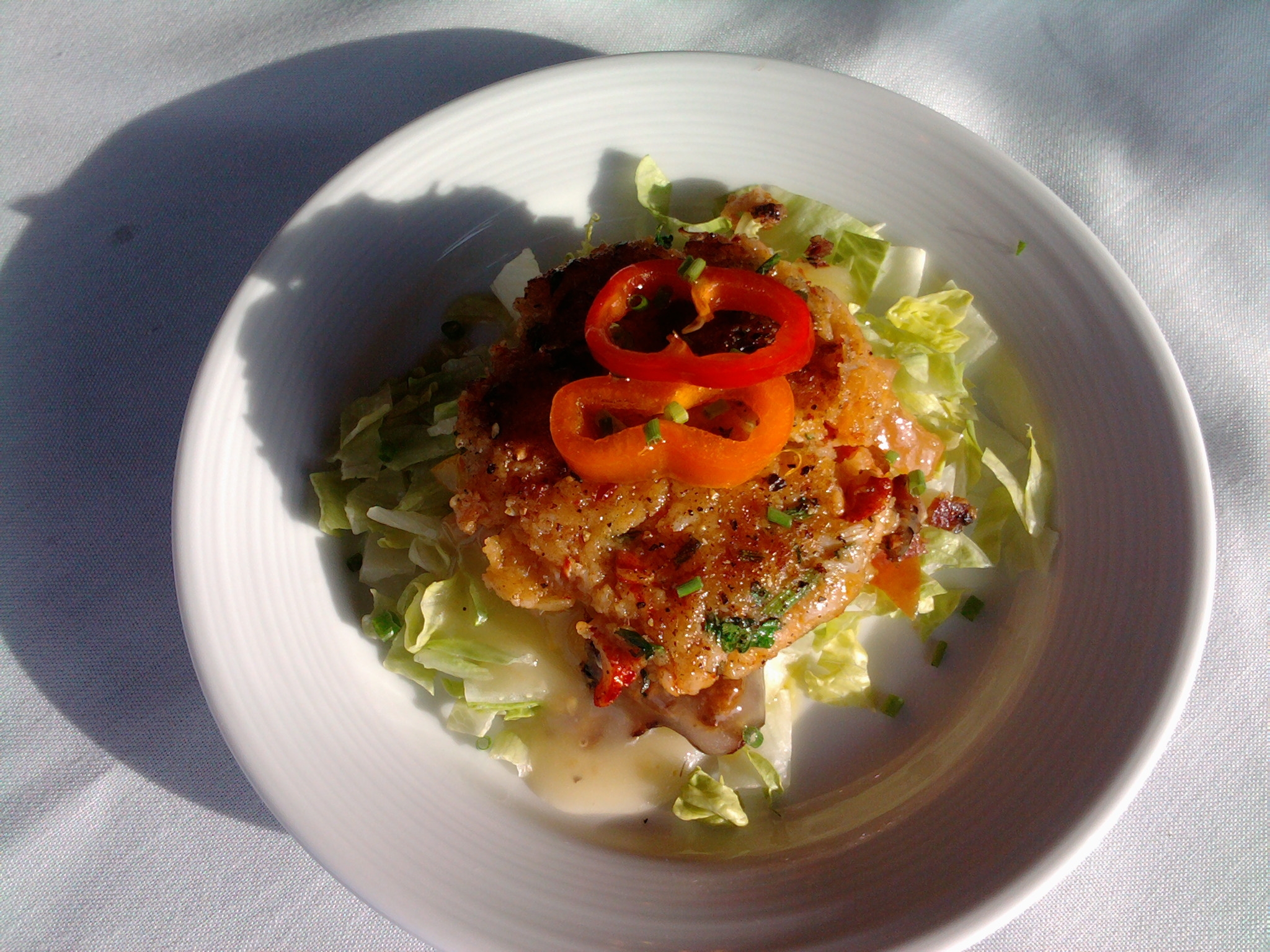 eastern ct :: pan fried crab cake over heirloom grape tomato salad