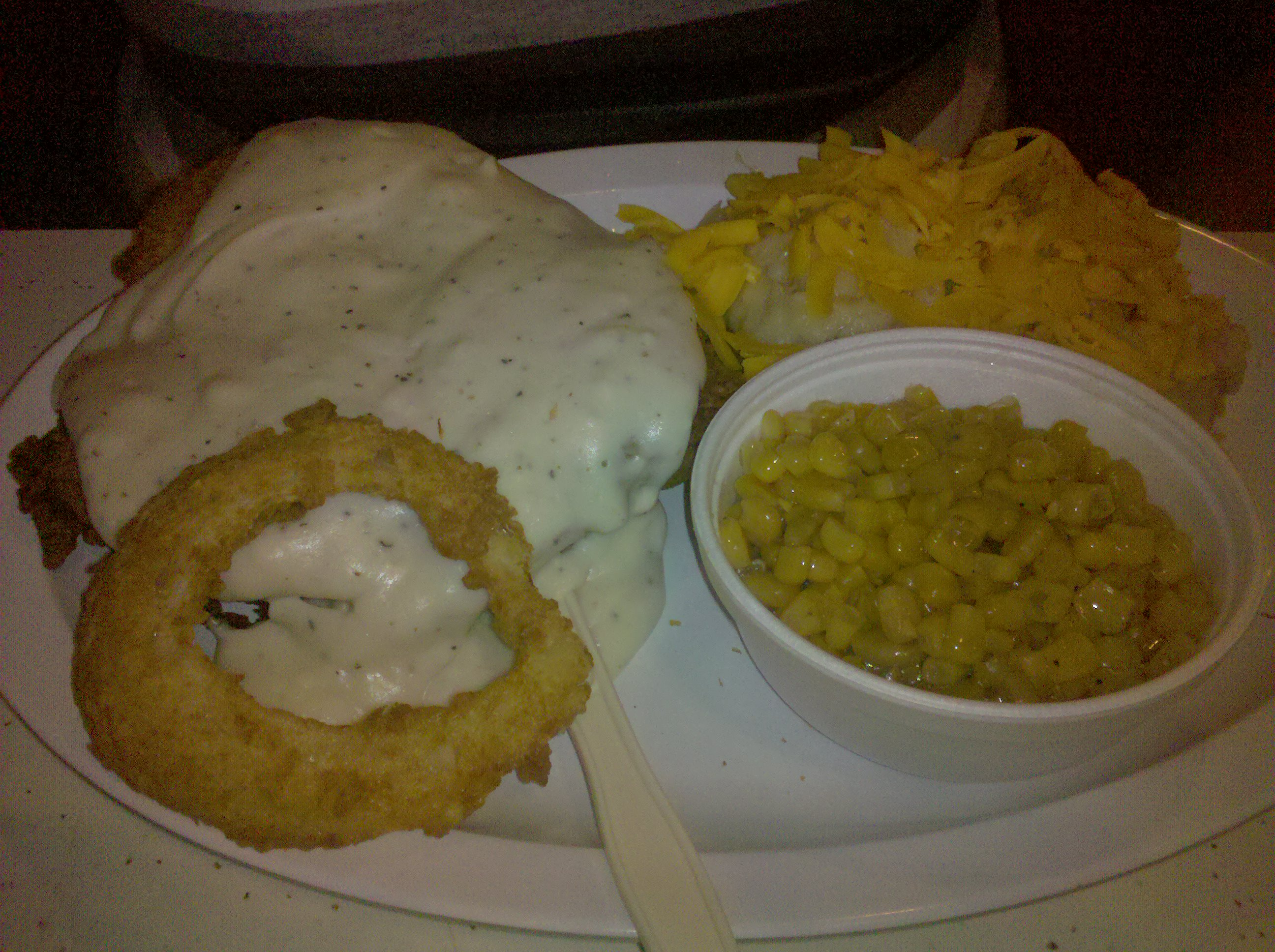 ClearSprings in NEW BRAUNFELS T.X :: Chicken Fried Chicken is under all that White Gravy. Sweet Buttered Corn and the Cheese taters was sooooo Creamy. TEXAS BABY
