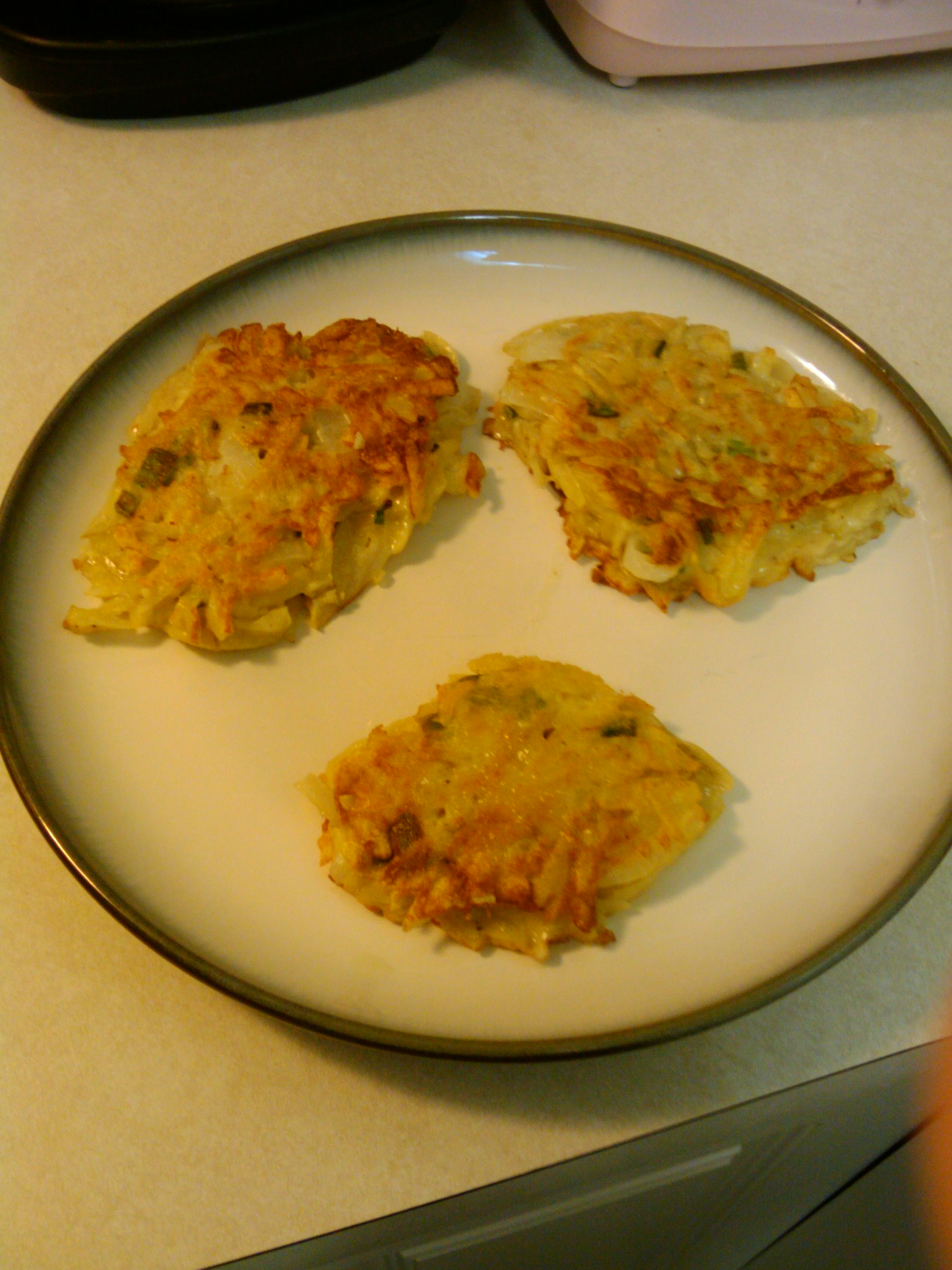 Orlando, FL :: Potato pancakes with onions, chives and spices.