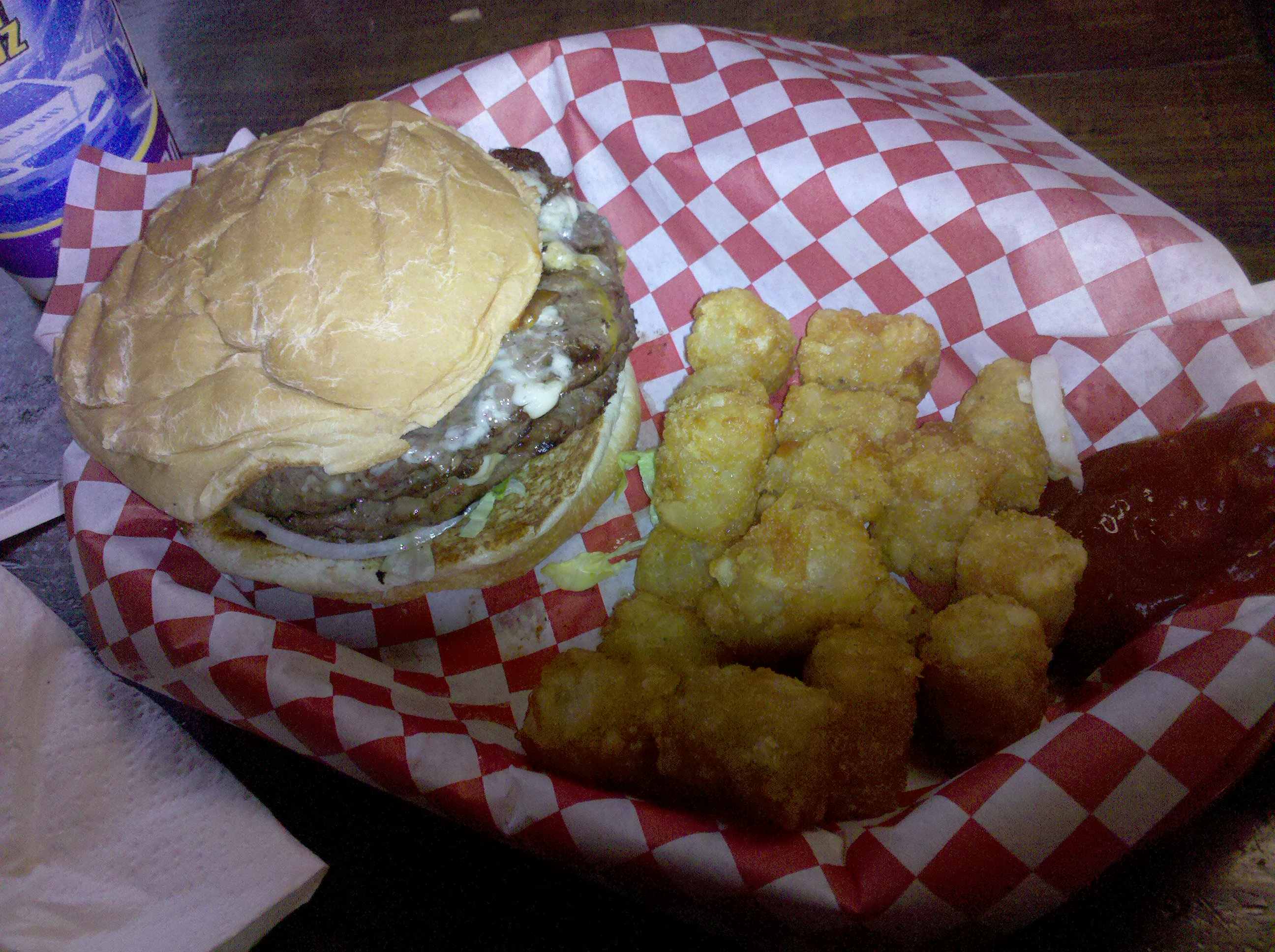 IttyBittyBurgerBarn Houston Tx :: BlueCheese and Bacon Burger & Tots. Serious 1/2 lb that doesn't skimp on the Bacon and BlueCheese.