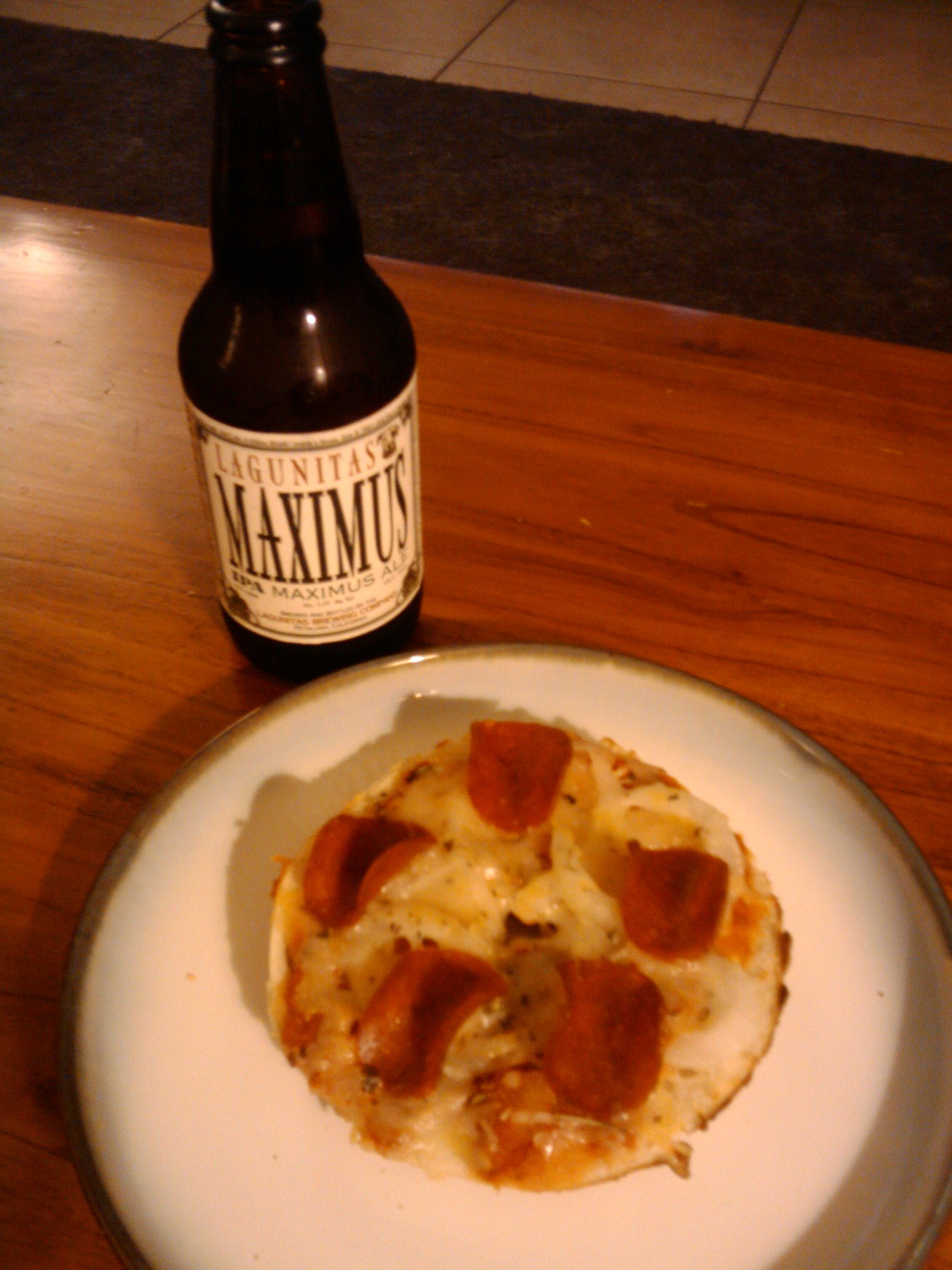 Orlando  :: parmesan bagel, sweet basil sauce, sweet onion,pepperoni, mexican 5 cheese, Italian seasonings. Lagunitas Maximus IPA beer @ 7.5% alcohol content. No verbs needed, only adjectives like delicious.