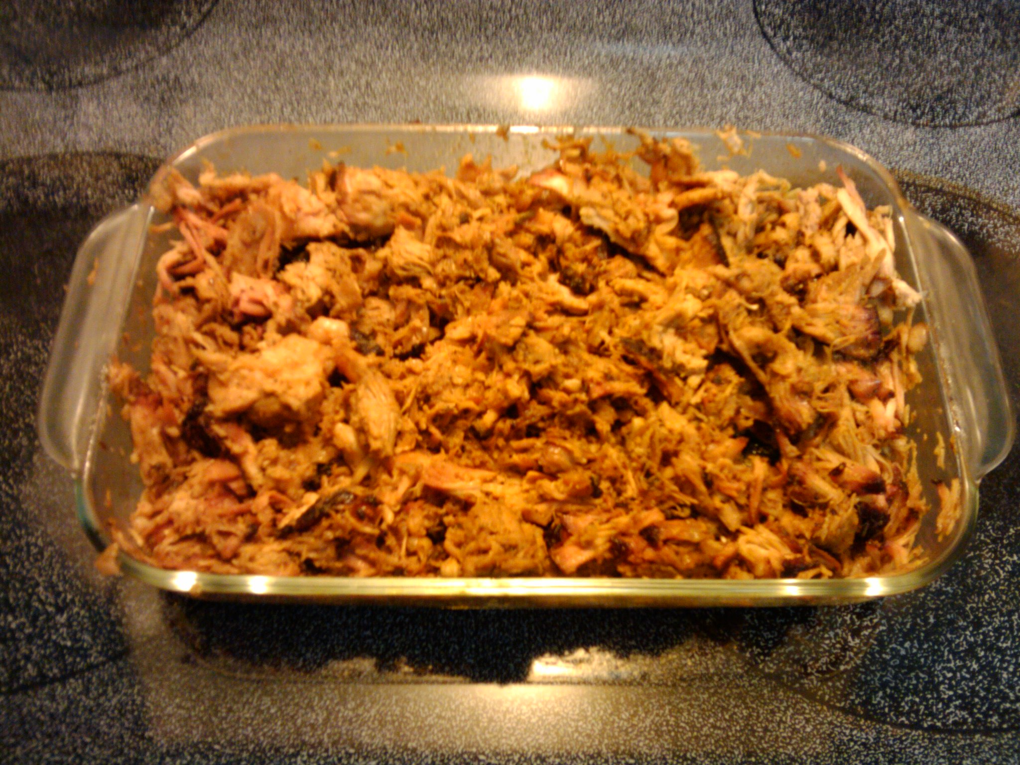 Orlando, FL :: 1st attempt at pulled pork. 9 hours on the grill. Done at 3 am. Made my own rub and sauce.It tastes awesome!Glad I did IT!