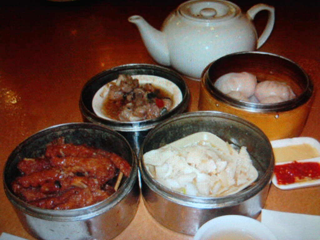 eastern ct :: dim sum in boston's chinatown. there's spicy chicken feet,steamed beef stomach,shrimp dumplings ,pork ribs in black bean sauce and jasmine tea