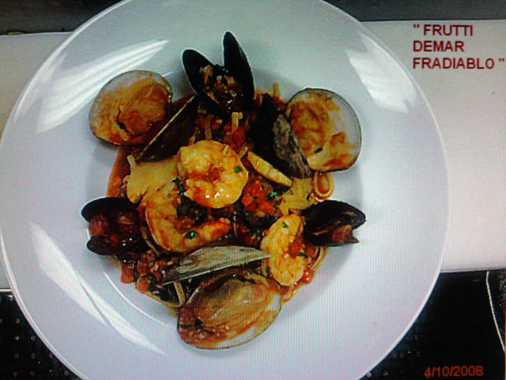 eastern ct :: shrimp,scallops,mussles and clams in a spicy marinara with linguini
