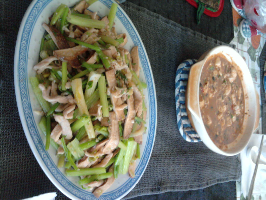 eastern ct :: shredded pork and 5 spice doufu with chinese celery. in the back pot,mother chen's mapo doufu-a spicy mix of ground pork,doufu in a firery sauce.