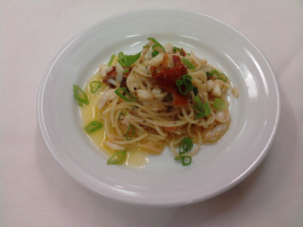 eastern ct :: crab with roasted tomato and angel hair pasta tossed in a lemon zest pickled ginger wine butter.