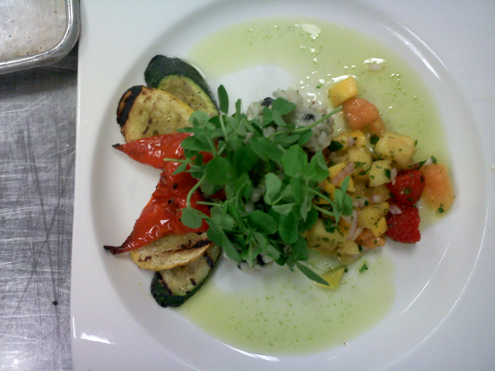 everett ma :: coconut rissotto with a passion fruit salsa grilled veg and scallion oil topped with pea greens