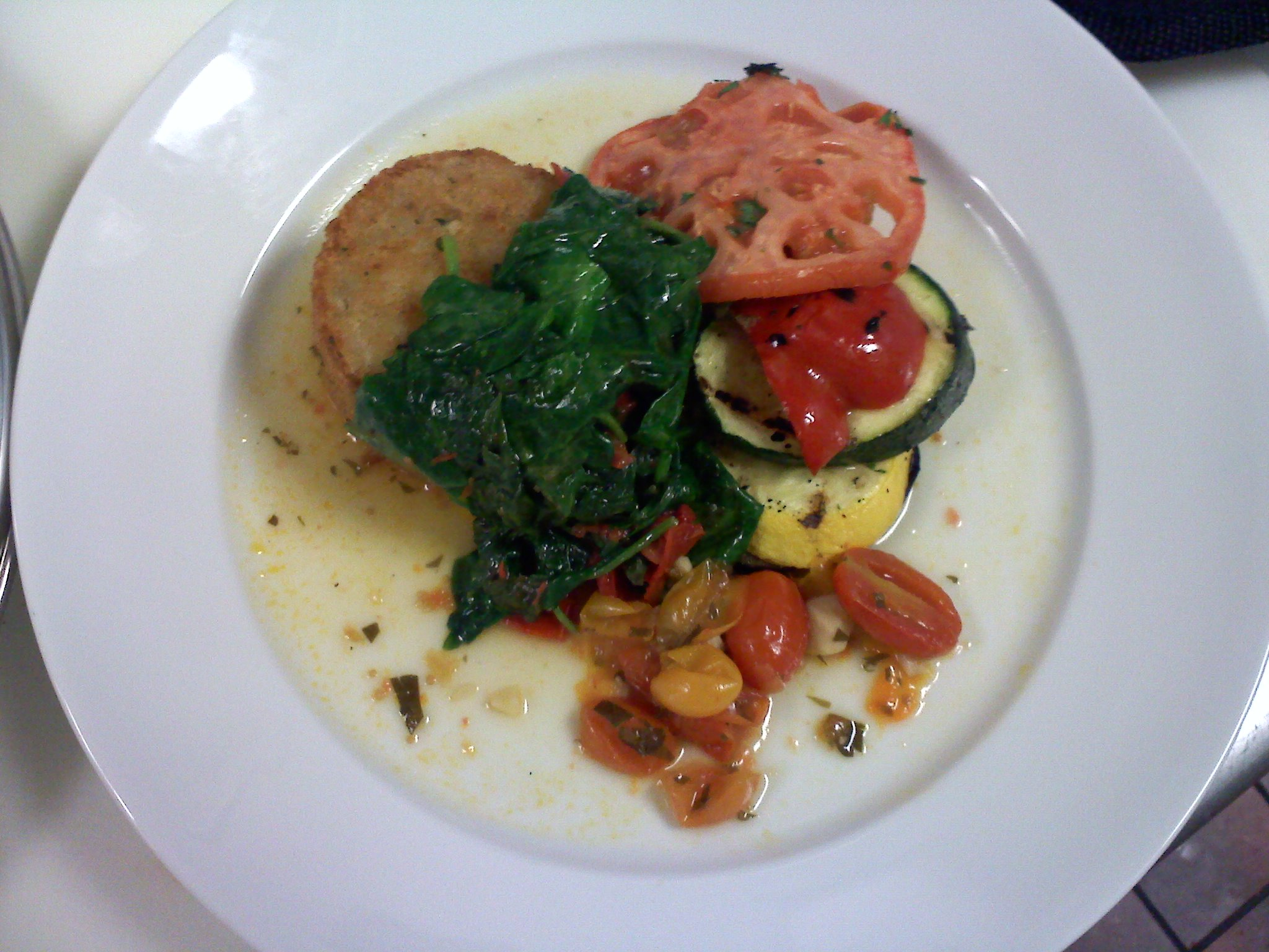 everett ma :: fried rissotto with summer veg stack sauteed spinach and rst tom with a rst tom broth