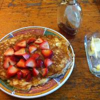 Sour cream pancakes, organic strawberries, and Vermont maple syrup.
