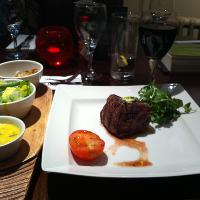 Petite fillet, roasted tomato, mixed greens and bergnaigse sauce.