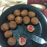 Italian meatballs with some sort of goya hot sauce