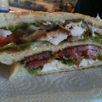 "Welcome to ""Megga-Man Club-Sandwich"" - bread, bacon, chicken, mayo, tomato, onion, lettuce, salt and pepper."