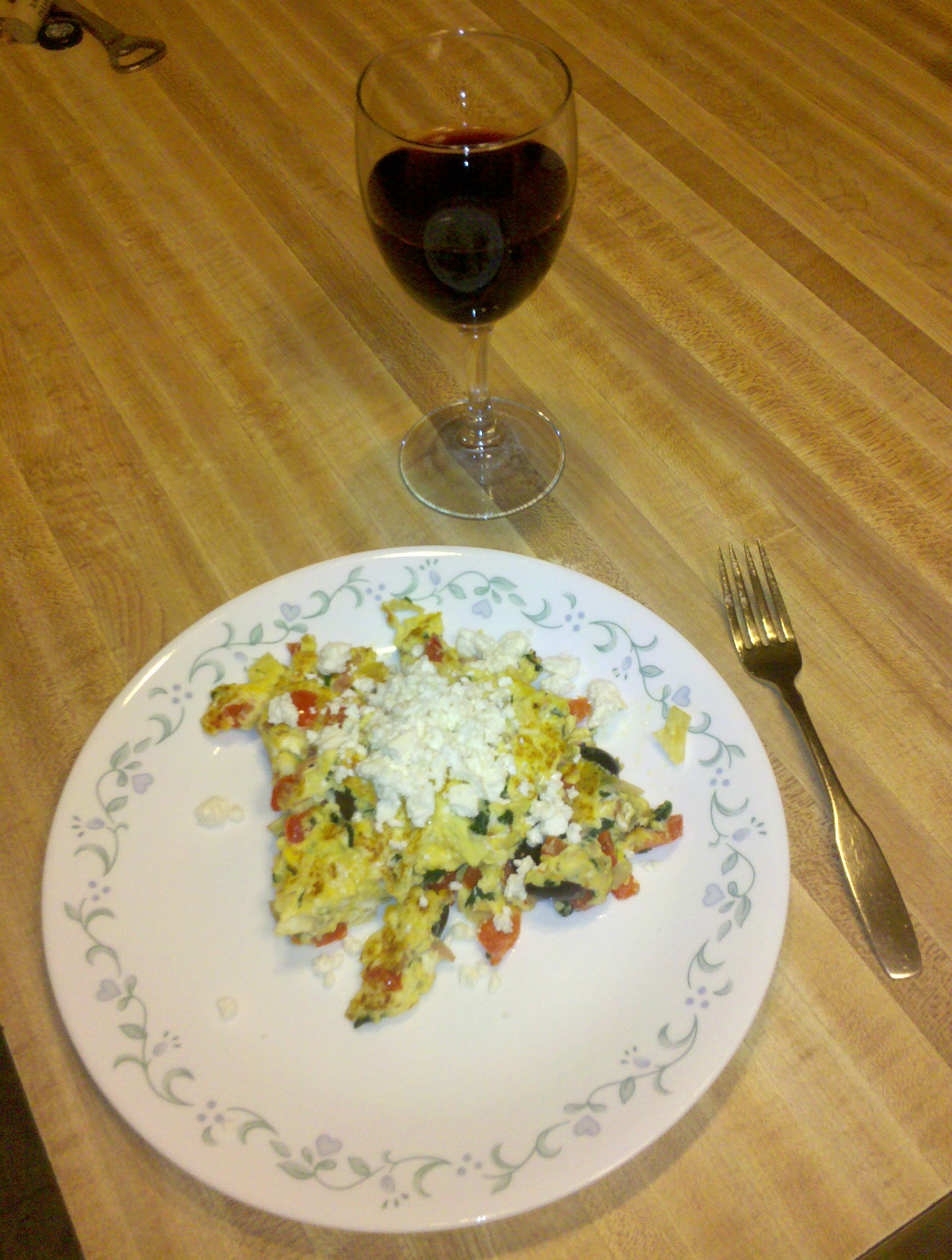 Home, Milford, NH :: Eggs with red pepper, onions, garlic, ham, spinach, kalamata olives, topped with Feta cheese, and a glass of red wine.
