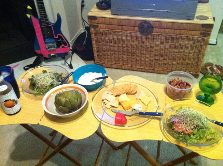 Texas home :: Cheese plate w/ glazed pecans, artichoke and dip, garden salad, cheap Chardonnay.