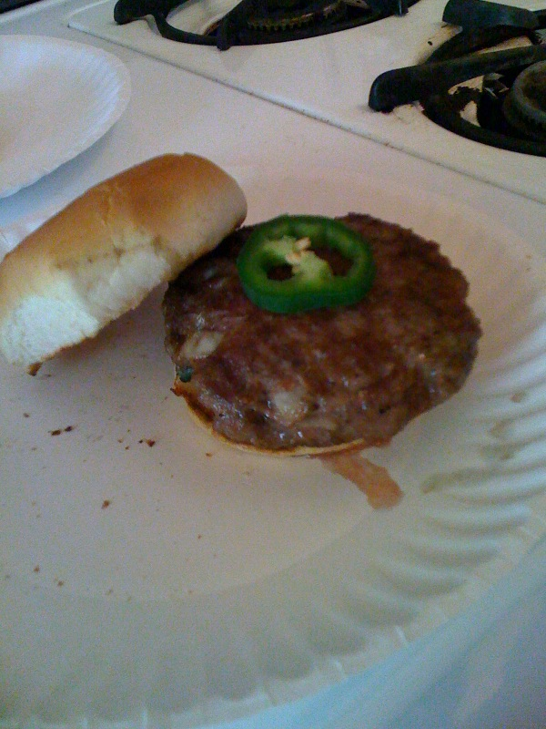 My house Cambridge, MA :: Seth made some burgers with a hot pepper in it and some onion... really yummie burger!!!!!!!!!!  topped with a slice of hott pepper just for an added kick!!  I ate mine in like 4 bites!!