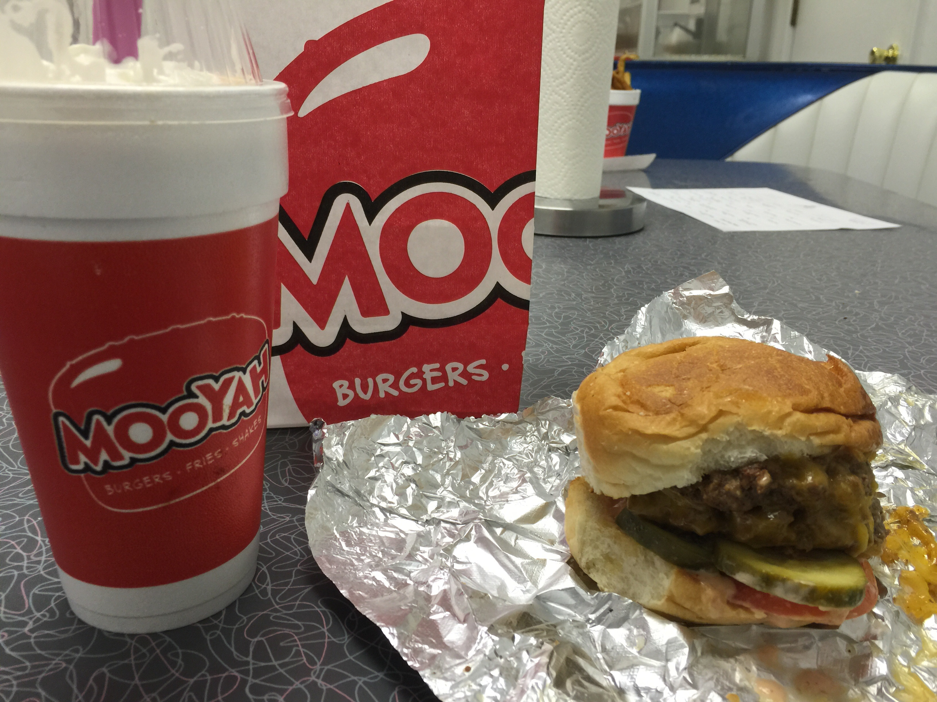 Mooyah Newington CT :: Double Mooyah burger. Pickles tomatoes cheese