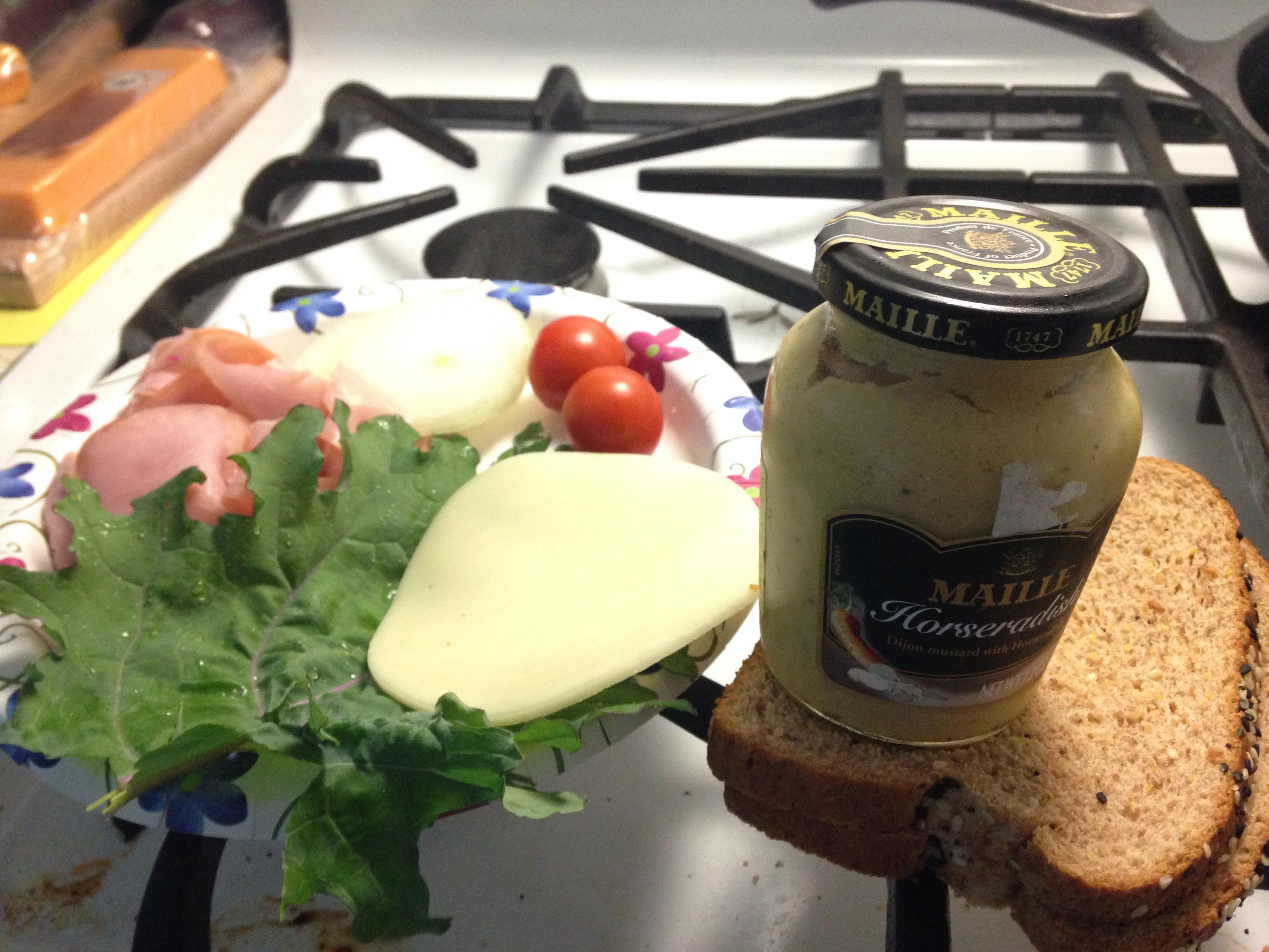 :: Ham sandwich w Russian kale garden tomatoes onion provolone and horseradish mustard