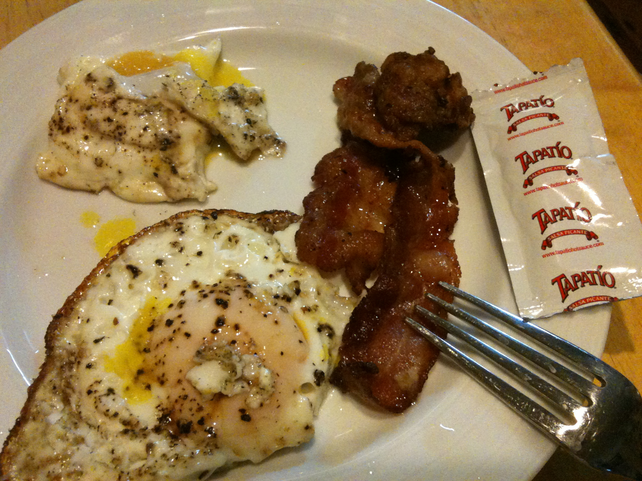 Cambridge  :: Late night eggs, bacon and packet hot sauce snack!!  I took this picture before the toast was done. Oops!!