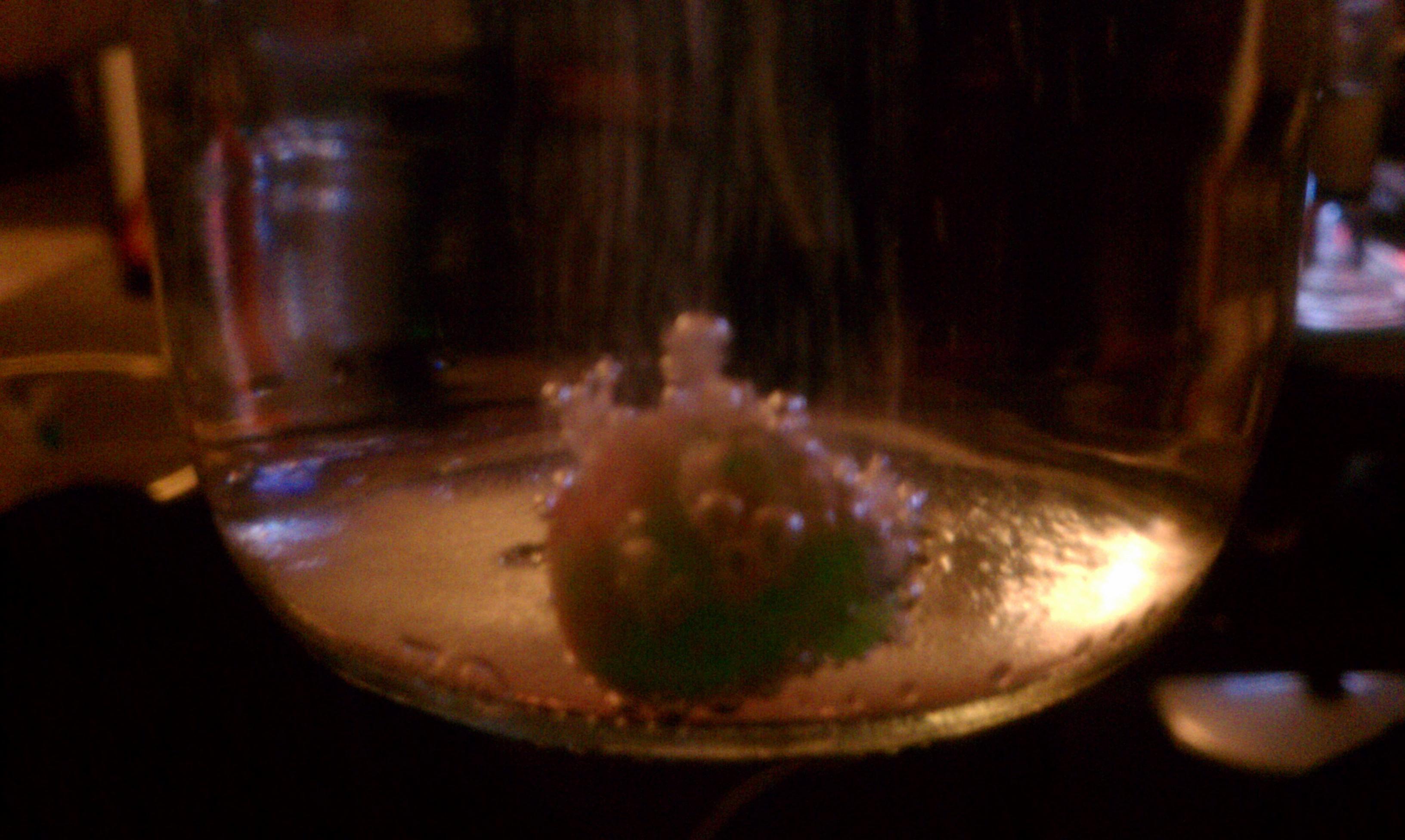 My living room, washington :: Trolli gummi rocks, dropped in pineapple smirnoff