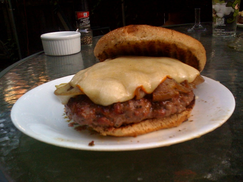 "My House Back-YardCambridge, MA :: I call this a ""Man Burger"". it was home made by my self and eaten by the same!!! it had cheese on it!!! and I had some pickles on the side of my plate"