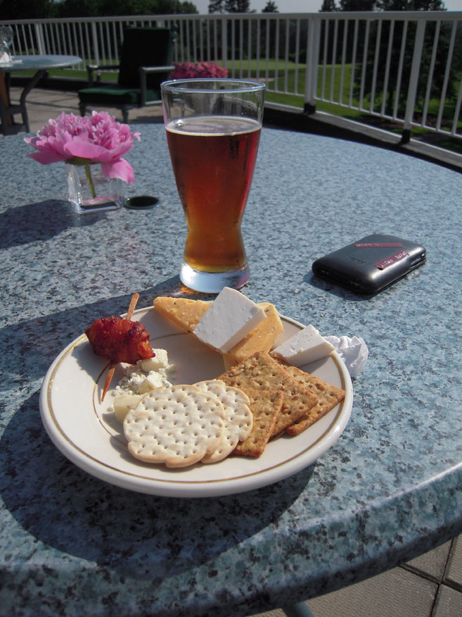 Ledgemont Country Club Seekonk :: Bass Ale with some triangley cutt cheeses… one of the cheeses was white in color that had an interesting taste…. Crumbled like a feta but wasn't… I took some crackers but ate them alone with out the cheese…. A scallop wrapped in bacon mixed in there as well