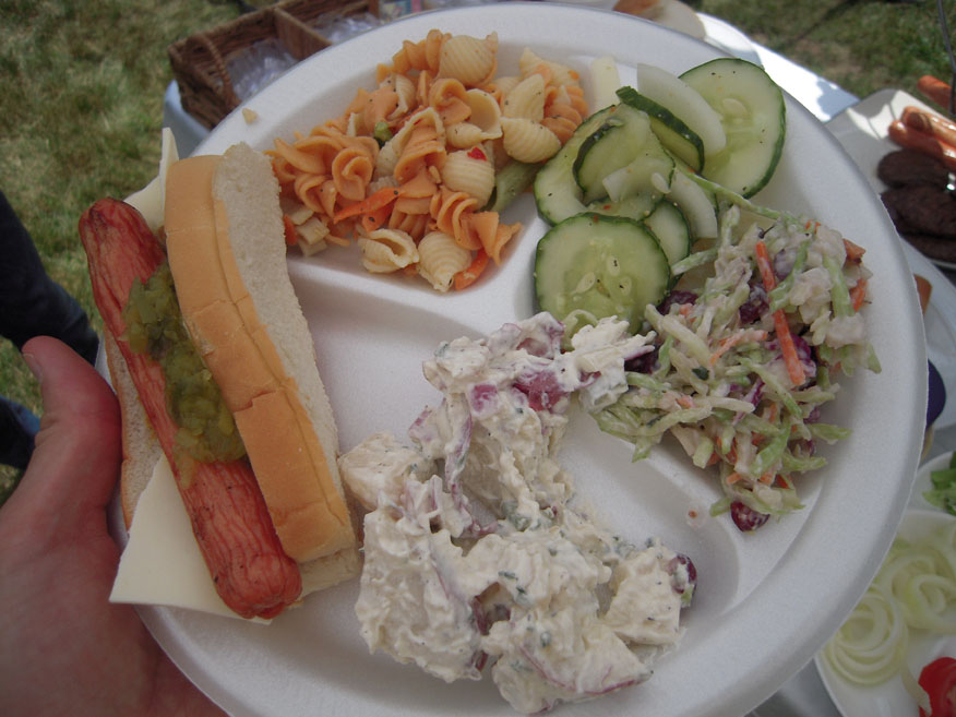 Scott and Amy's house CT :: most times I am first to the food... at this backyard grilling/party I was first to grabb the fresh dogs off the grill... I also added cheese on all the dogs I ate that day!  Pasta salad Cucumber salad and some coleslaw ended up on the plate too... I ate it all and went back for more!