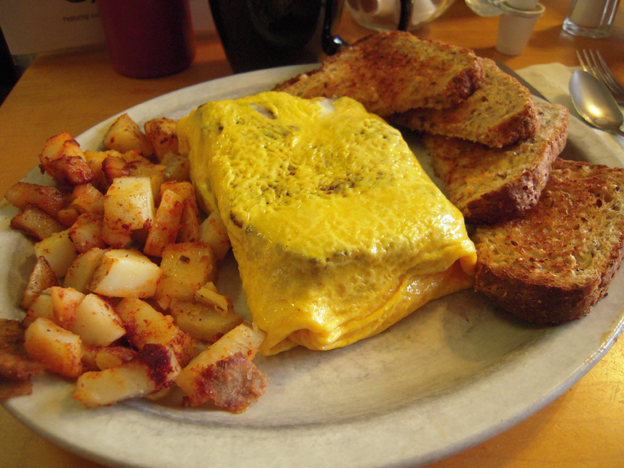 River House Cafe Milford, NH :: what do you think this is???? it looks like an omelet but why is there a square chunck of Meat-Loaf in the middle?? oh I know... it is a meatloaf omelet!
