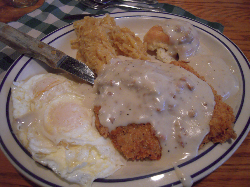 "Machine Shed Rockford, IL :: This was my breakfast at The Machine Shed! I had Chicken Fried Pork, 3 over-easy eggs(if you say ""I love eggs"" they give you an extra no cost egg! I did and that is how I got 3 eggs!), Bisects and Gravy, and the Casserole..."