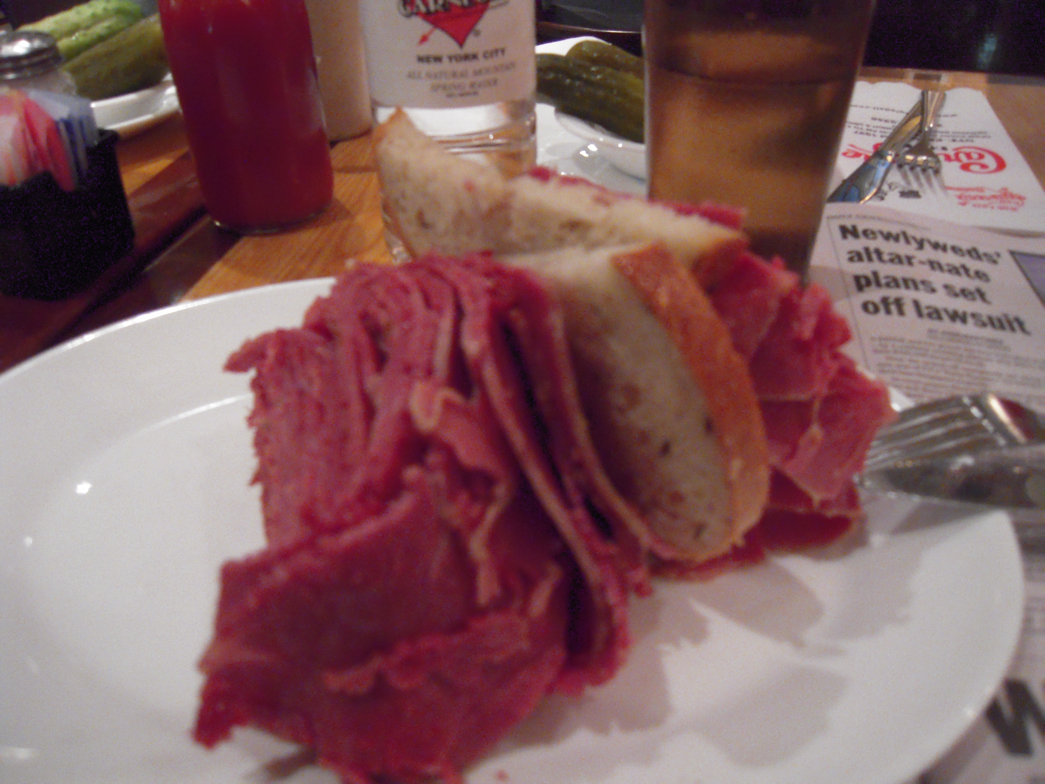 Carnegie Deli (NY,NY) :: The world famous corned beef sandwich. You can't eat it like a sandwich, but for $15, would you expect to? Plus, the free half-sours they give you with the sandwich are also the best in the world!