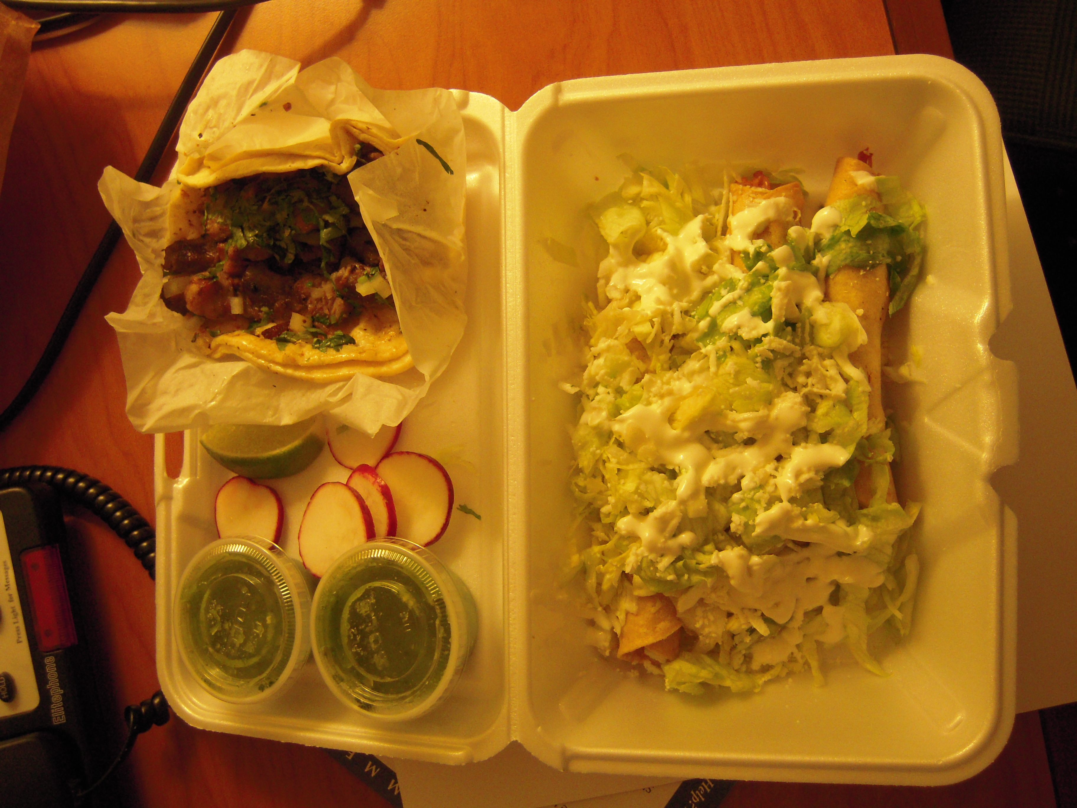 Astoria, Queens (NY) :: Flautas and a carnitas taco from La Flor de Puebla at Astoria Blvd and 38th. Super yummy late night snack with all the fixins, from salsa verde to lime slices and radishes. Real Mexican food!