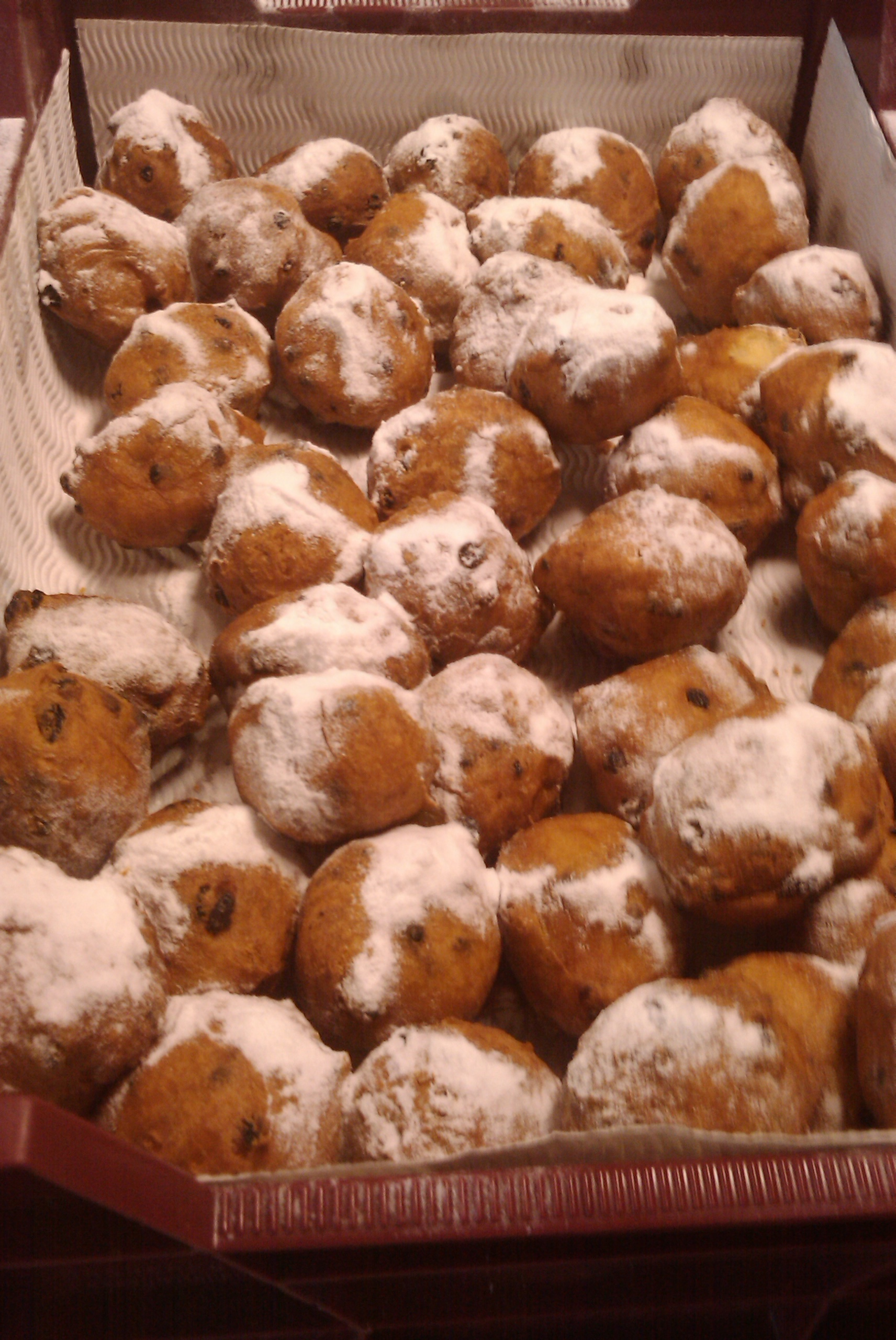 naaldwijk Holland :: dutch oliebollen.. this is a original dutch treat, deepfried dough filled with raises and topped with sugar. this is where the donuts are copied from!