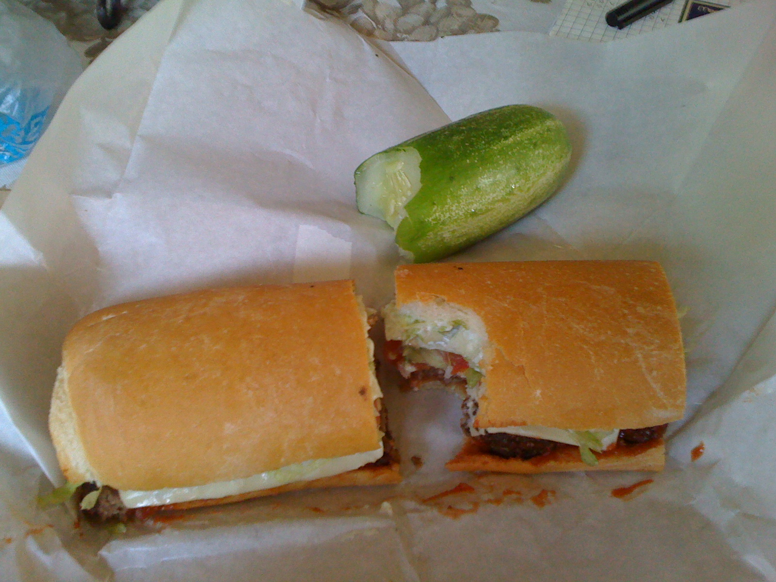 Elsa's Bushel and Peck Deli :: Hamburger on french bread with half sour pickle. Awesome.