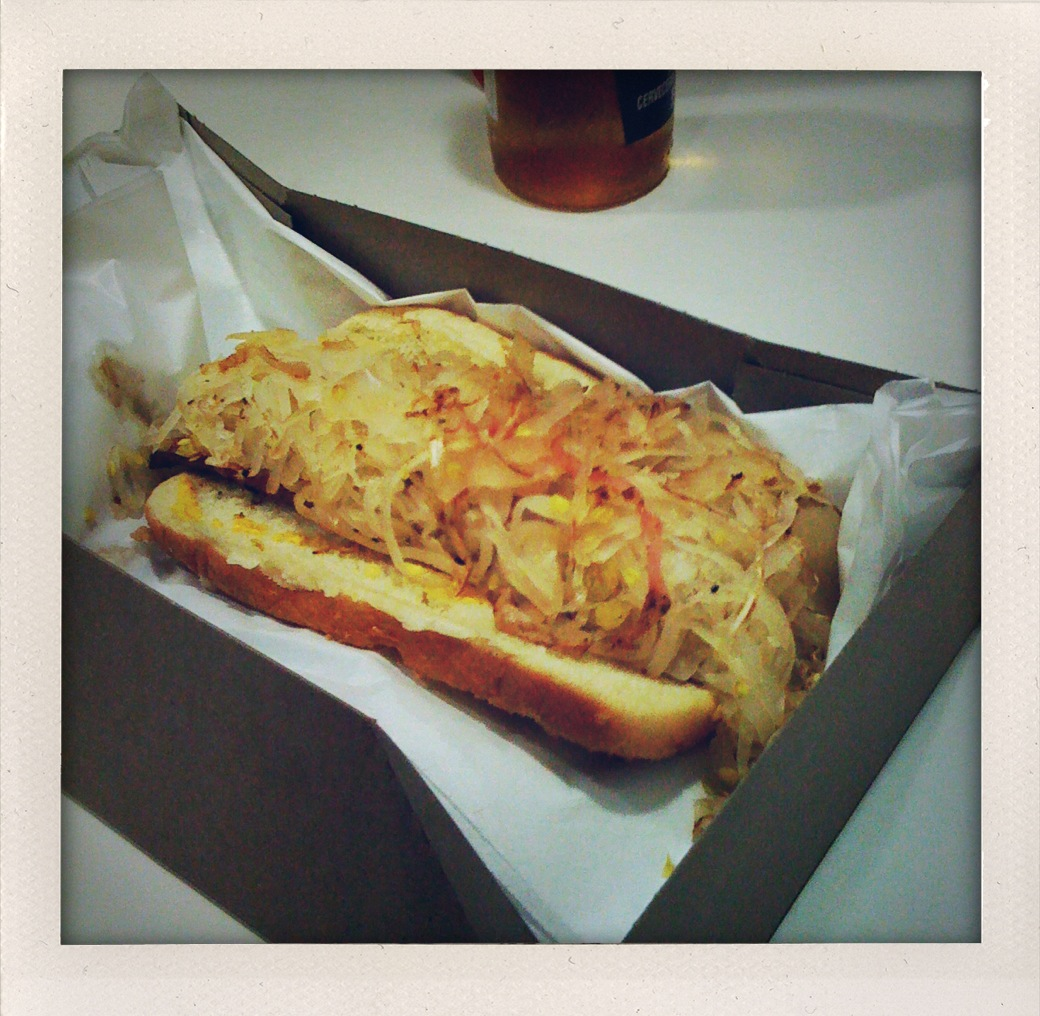 Carney's Restaurant.  Hollywood, CA :: Underneath all this kraut there is a hot dog.  I was told that it would be the best ever.  It was really spicy and full of flavor but I prefer the white hot dogs with hot sauce from Rochester, NY.  Also, this restaurant was a train car.