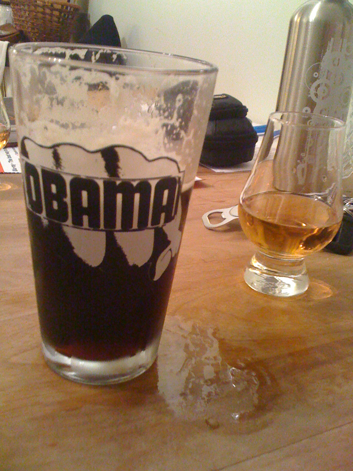 Brothers house Portland, ME :: some Midnight Porter from Sebago in an Obama glass and some scotch on the side... they are fists on the glass because Obama punches people!