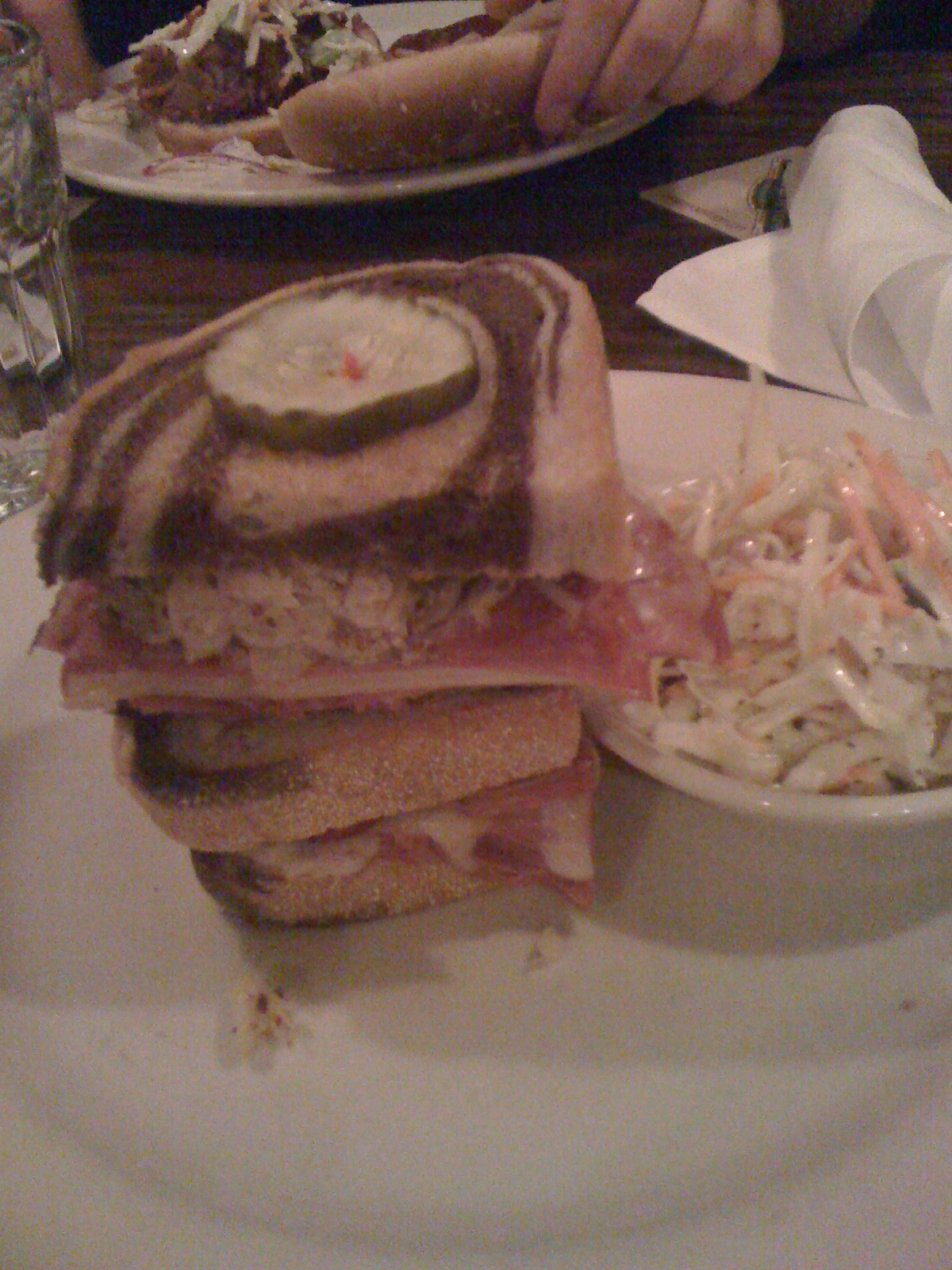 Rock Bottom - www.rockbottom.com :: I am a sucker for reuben sandwiches... I saw this on the menu and just HAD to order it.... it was ok for a crappy place to eat...  The staff is not trained to take orders correctly though... my brother ordered a Pulled Pork Sandwich and he got a Turkey Club... he told the wait staff that he had ordered a Pulled Pork Sandwich... they told him he didnt even though everyone at the table agreed that he had ordered the Pork....  how lazy are we to bluntly lie just to reduce burning extra calories!  go to the gym and give my brother his correct order!