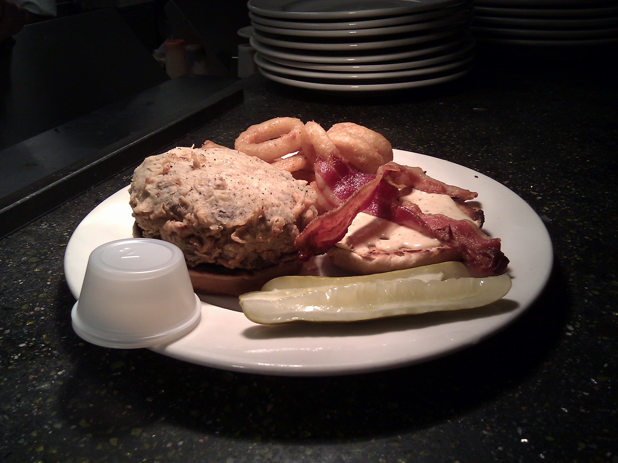 Gatehouse Tavern  :: The Kennyburger - a 10 oz fresh-ground sirloin burger, stuffed with bleu cheese, bacon, and diced habanero... cooked medium rare, then buttermilk battered and deep fried.  Dear Lord, someone get me a fistful of blood thinners.