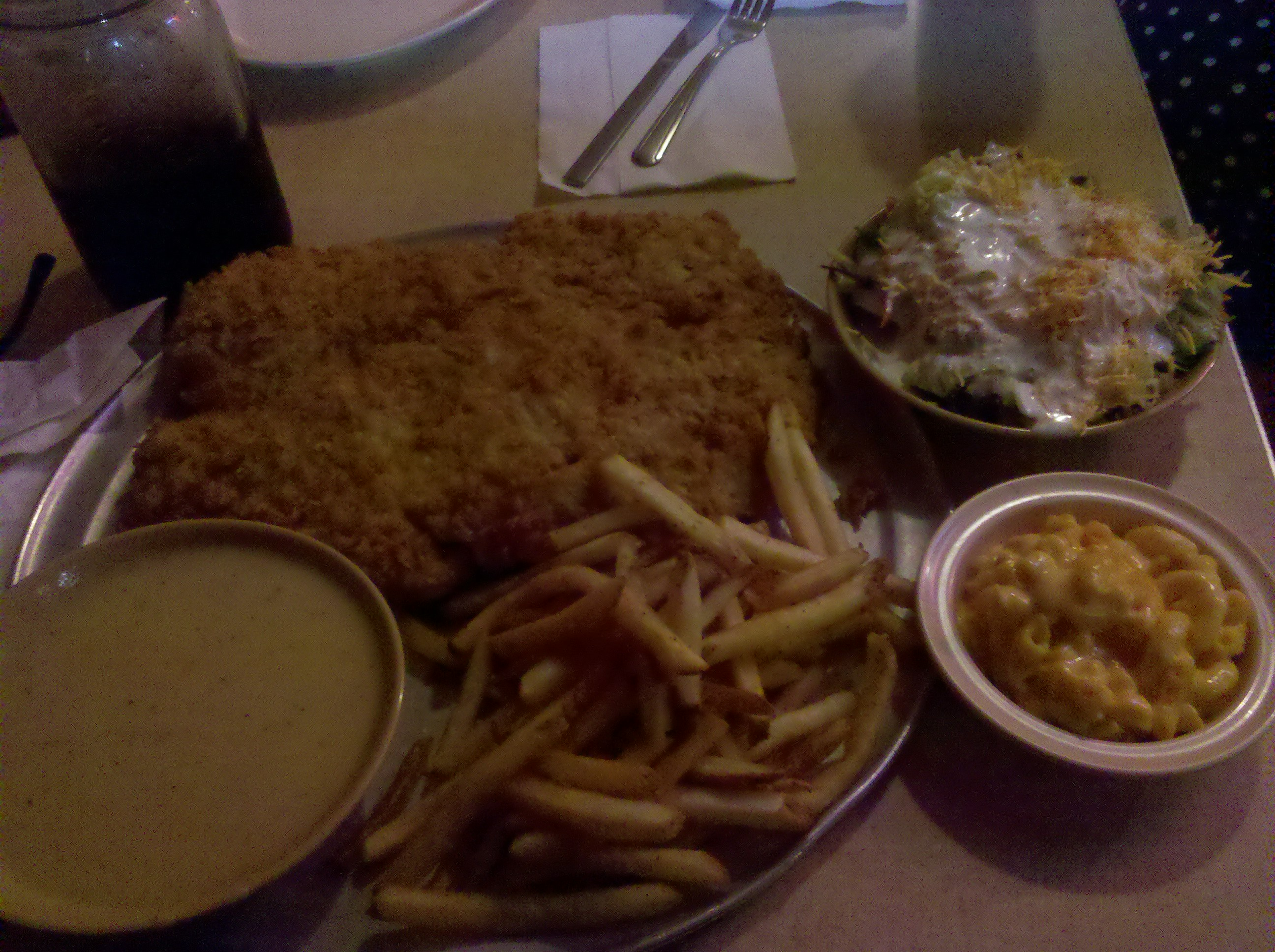 Hickory Hollow. TEXAS :: Everything's bigger in Texas, including this Chicken Fried Steak. So big it's served on a pizza tray. Fries and the MacNCheese was Tha Shhizzzz