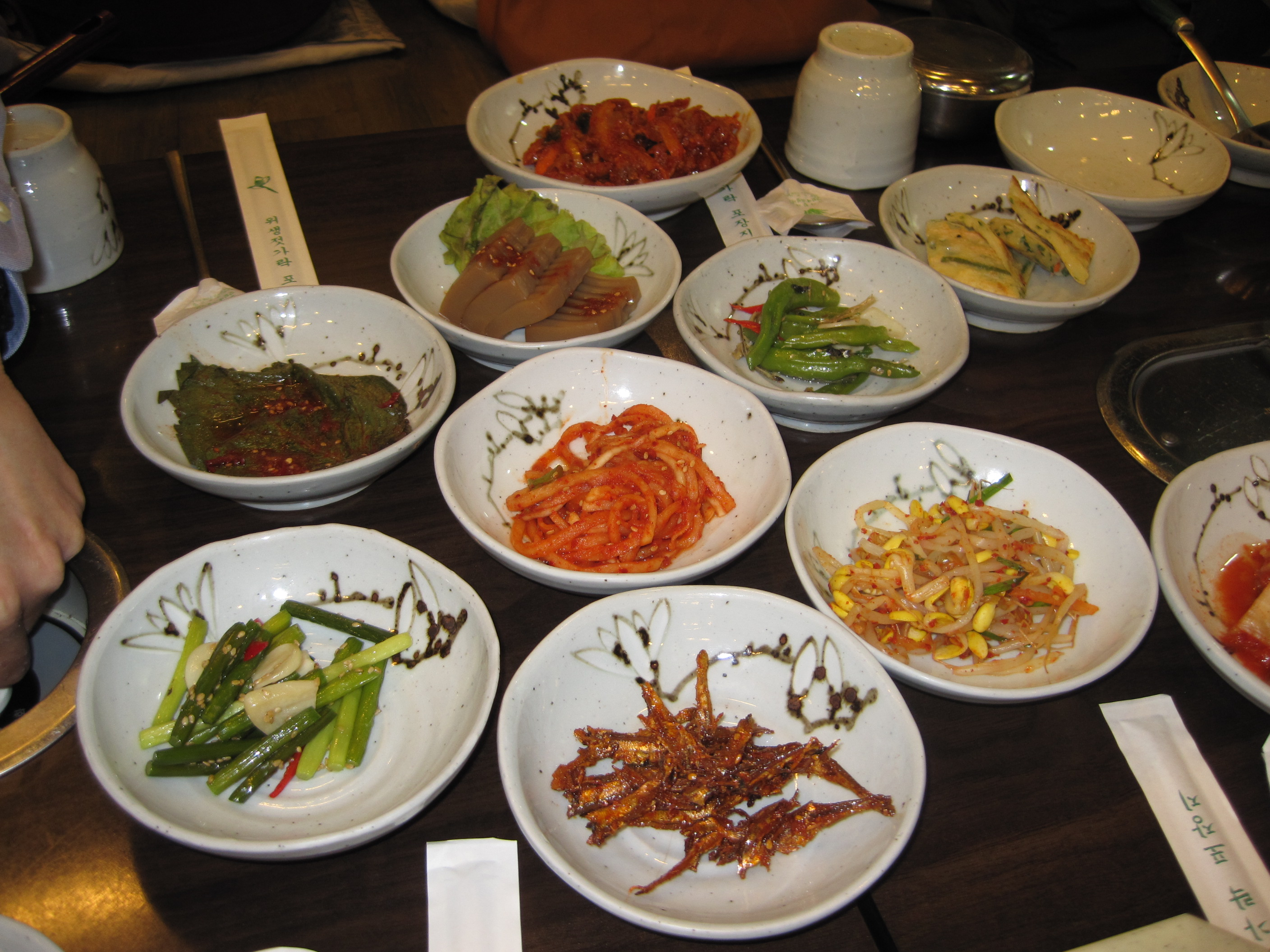 Seoul, South Korea :: Sides that came with soup. Bean sprouts, acorn extraction, dried fish, hot peppers, kimchi, other weird stuff!
