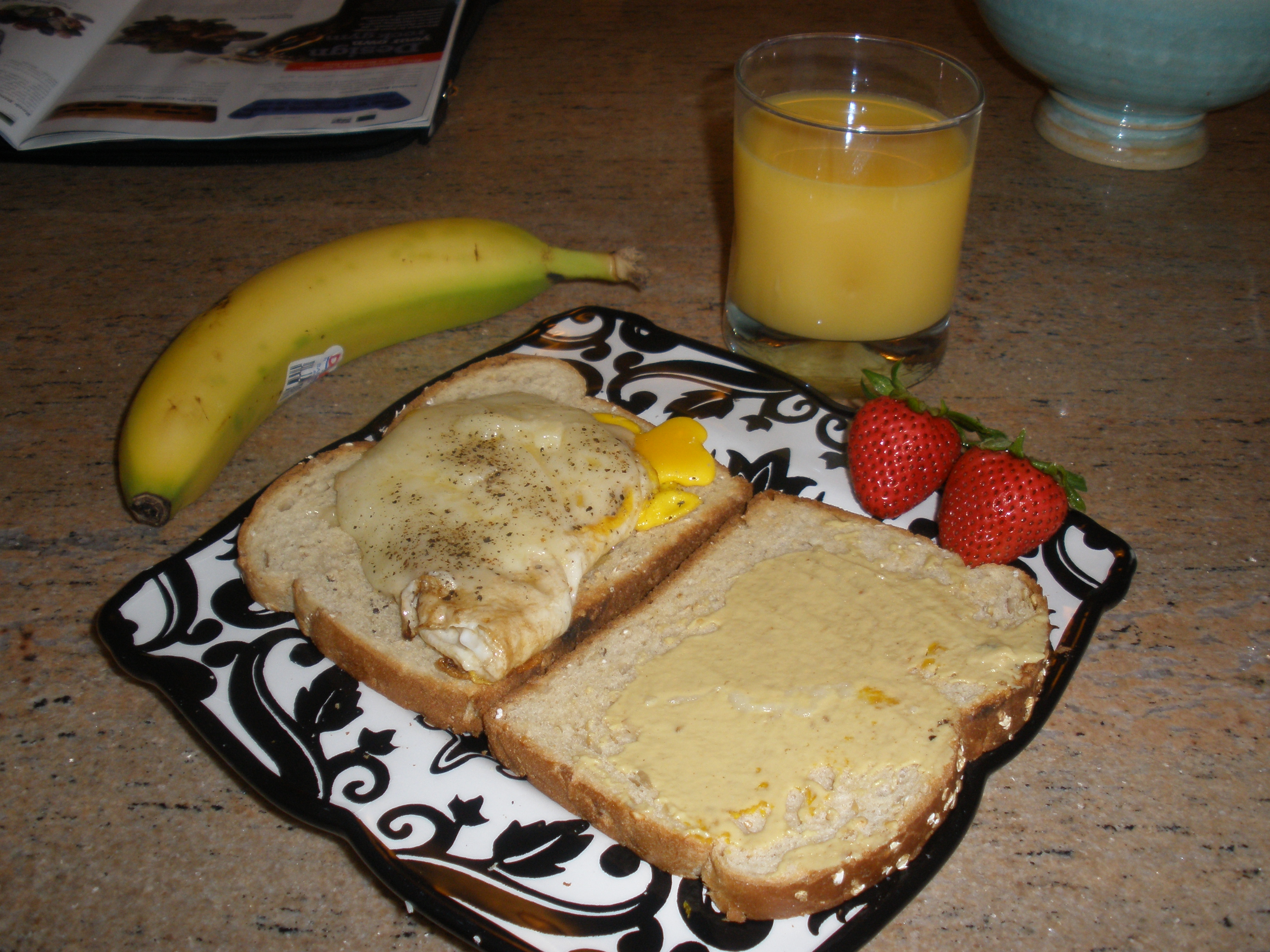 Home :: egg and extra sharp cheddar cheese sandwich on oatnut bread with cracked pepper and a smeer of grey poupon. strawberries and banana and oj for three different fruits!