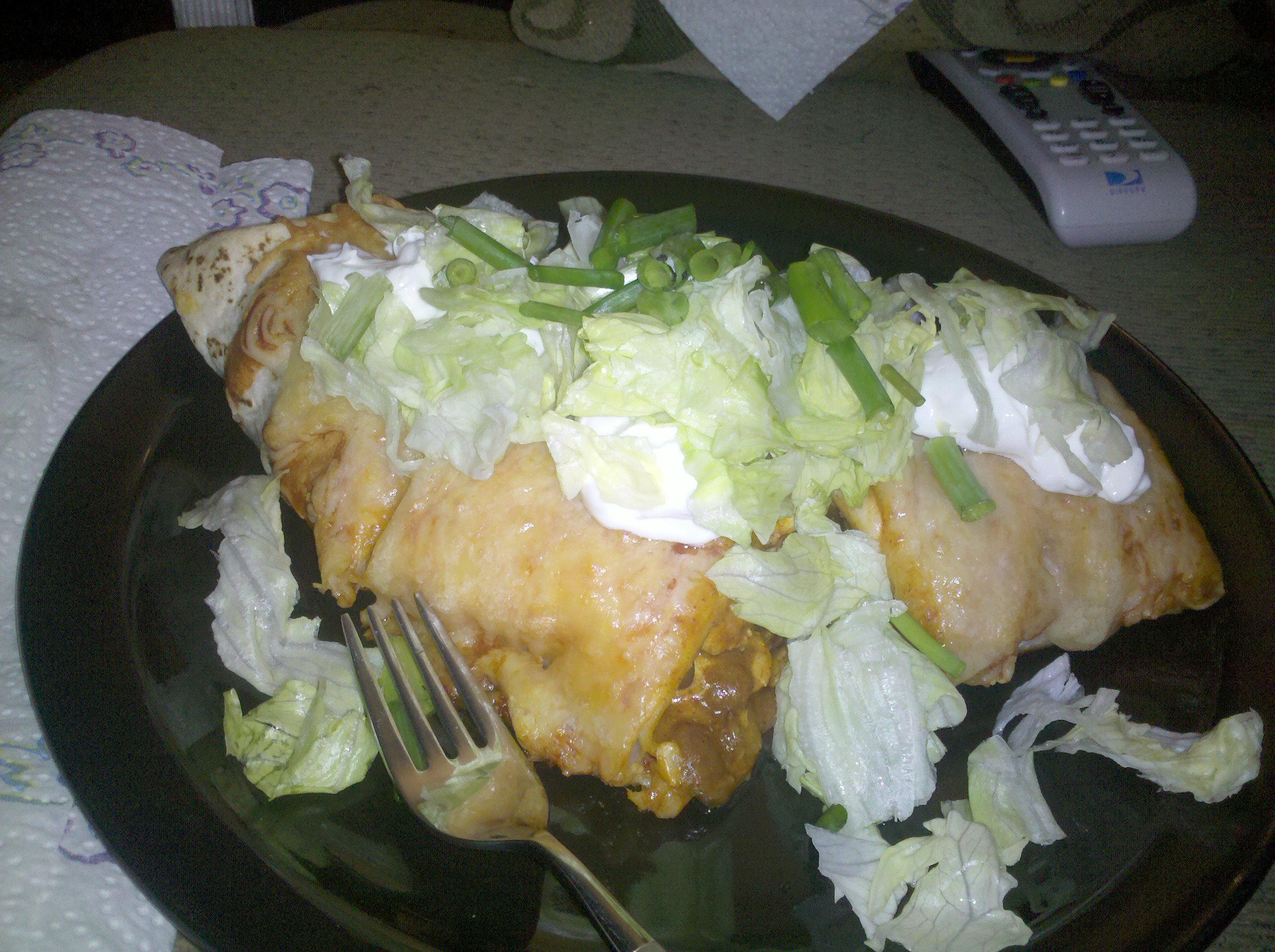 Lima, OH :: chicken with curry, garlic, etc, spicy chili beans piled high in 4 overlapped flour tortillas and topped with cheese, rolled up with taco sauce n more cheese!