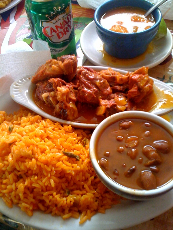 Izzys's Cambridge, MA :: stewed goat over yellow rice!  one of the best meals!!!  the goat meat looked red.. but that was what made it look red... goat is yummie!  beans too!!