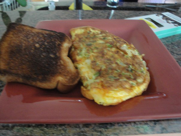 The Shire :: Green Peppers, Onions, and Mexican Cheese Mix Omelette.  And a slightly burnt piece of whole wheat toast.  HOMEMADE and fantastic!