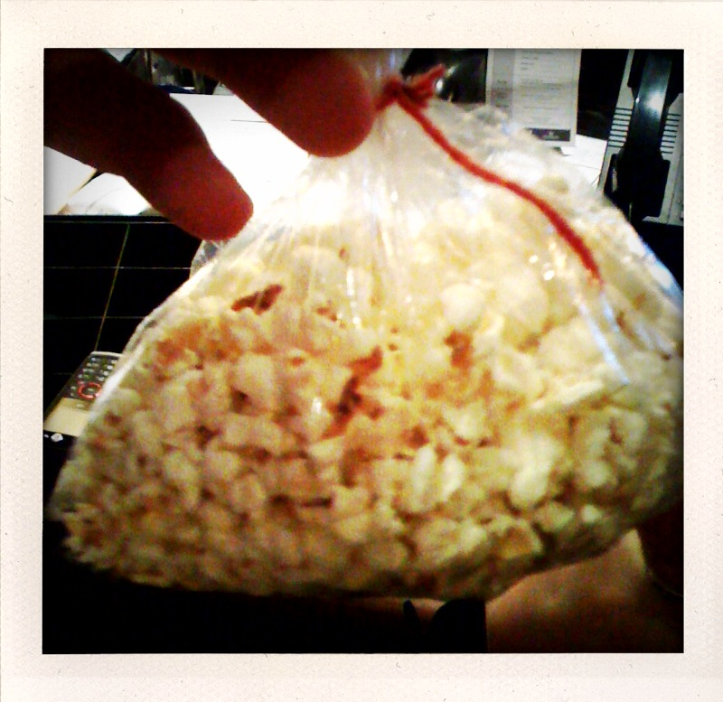 Marrioitt back room Cambridge, MA :: popcorn in a bag that Jessa gave me because I sent her a text saying I wanted popcorn! I like popcorn!