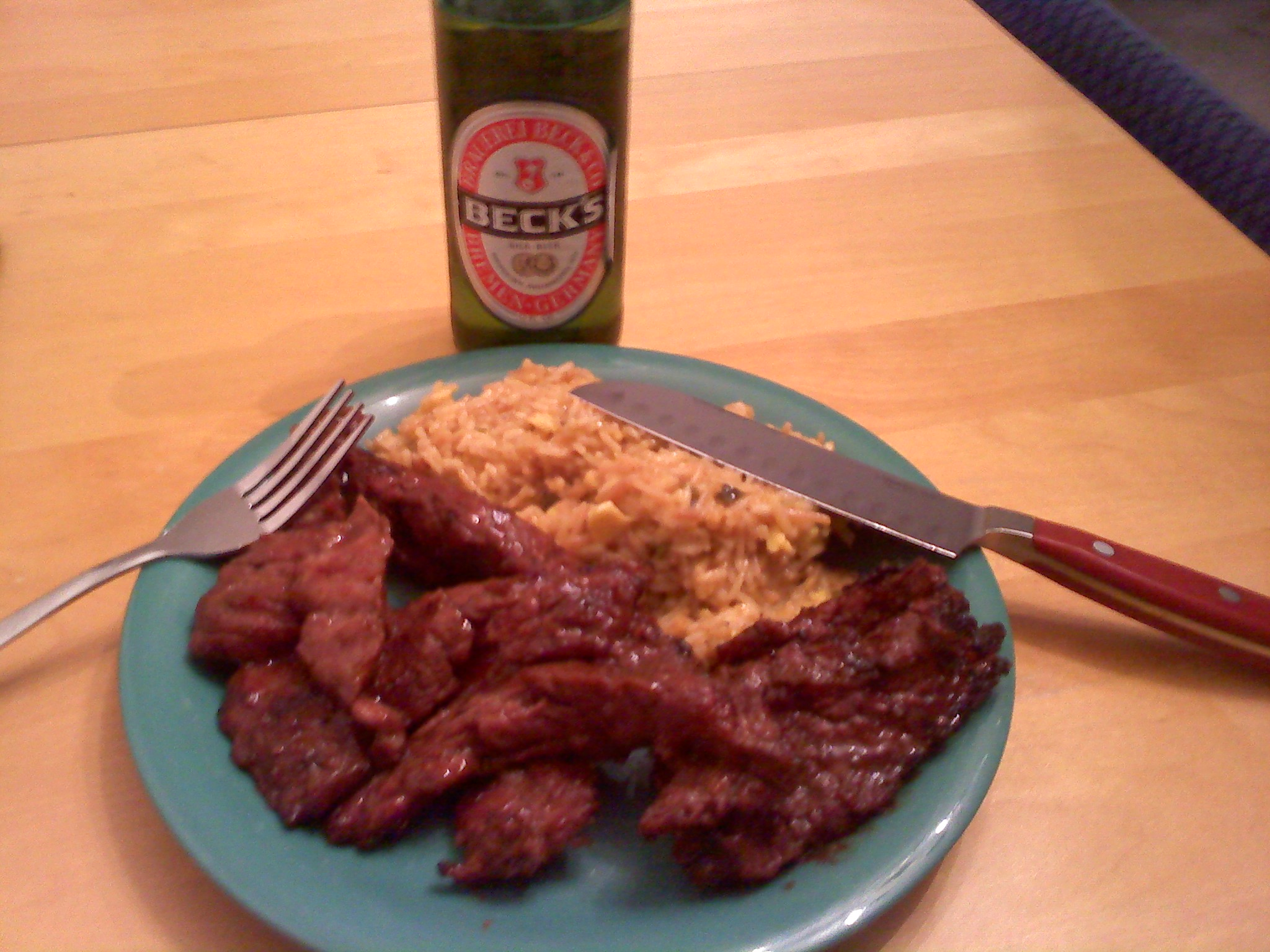 Nashua, NH :: Steak Tips marinaded in BBQ sauce, some Spanish rice and Becks.  Oh yah ... ran outta steak knives, so I had to use that one :-)