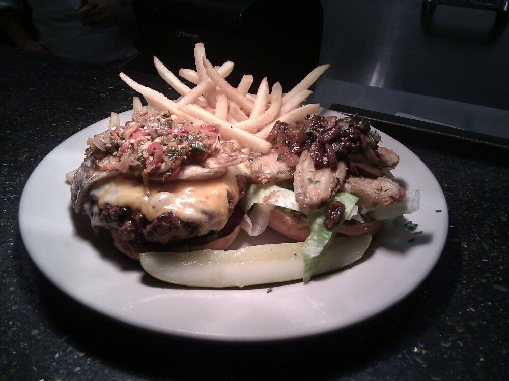Gatehouse Tavern, Wake Forest, N.C. :: a 10 oz burger with homemade sausage, cheddar and mozzarella, a habanero pepper blend, Guinness onions, fried pickles, shredded lettuce... I think I forgot something...